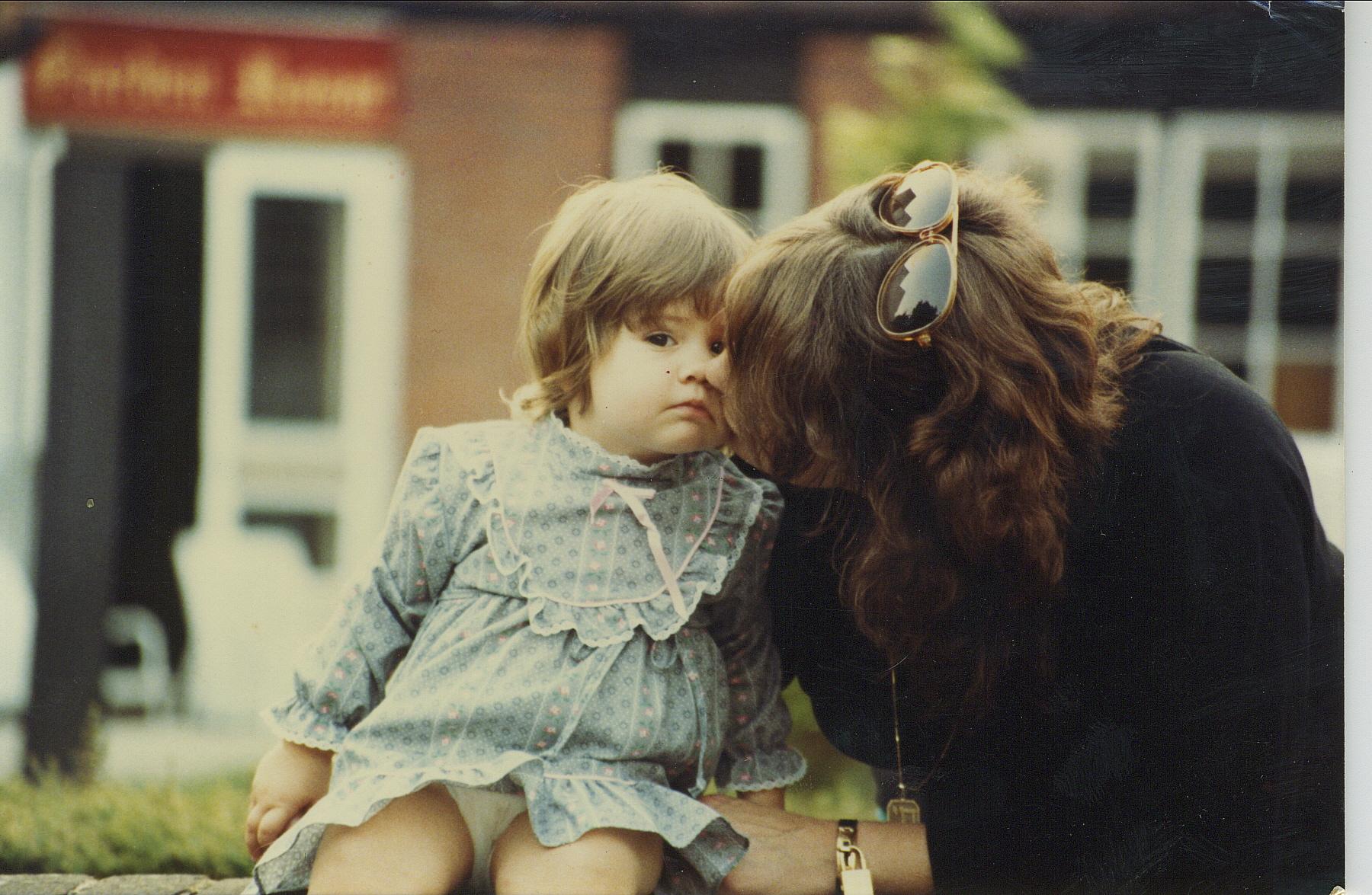 Mum kissing me as toddler